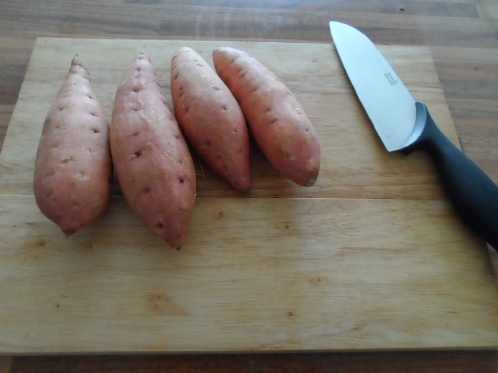 Sweet potatoes and knife